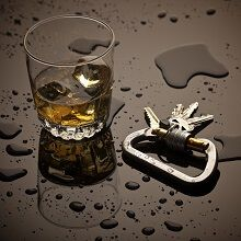Alcohol and keys on a wet surface