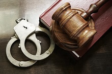 Handcuffs and gavel on a book